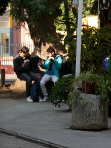 Chilean youth eating hot dogs, 2011
