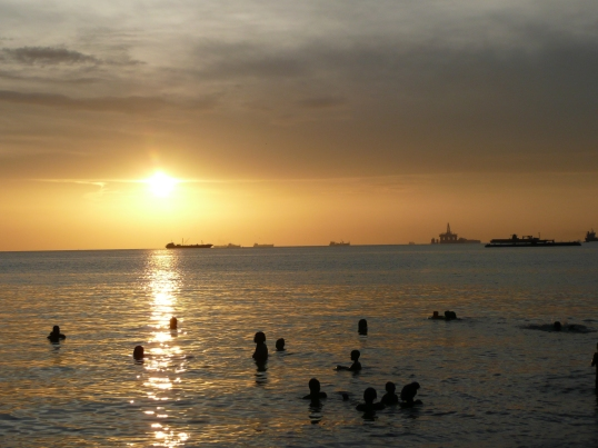Swimming at sunset, near Claxton Bay, Trinidad, July 2010