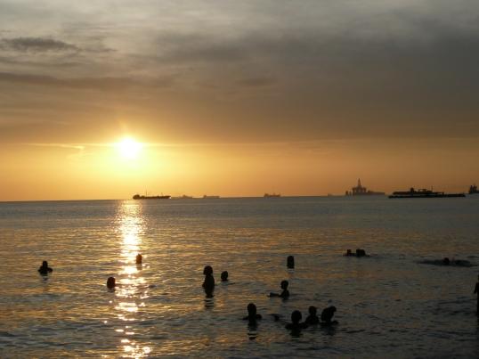 Swimming at sunset, near Claxton Bay, Trinidad, July 2010